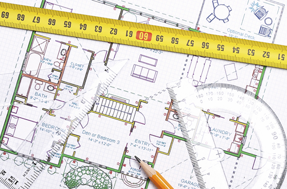 Topview of a measure tape, pencil and other tools on top of floor plan